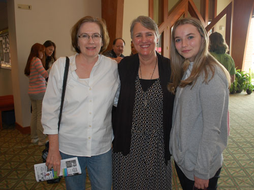 Board member with daughter attend Parish Visit