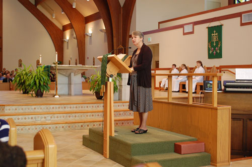 Debbie witnessing to the community of St. Alphonsus.