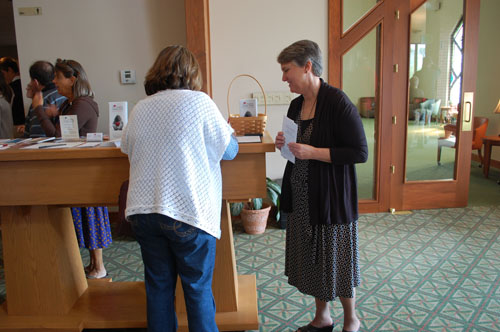 Parishioners signing up for prayer support of Healing Hidden Hurts.